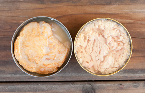 An open can of Island Trollers Albacore on the left, and a can of grocery store tuna on the right. You can see the difference right away.