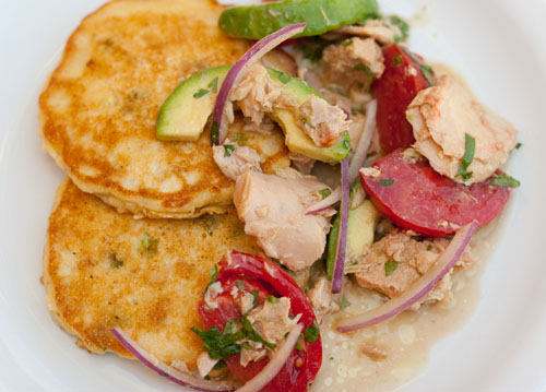 Island Trollers Summer Salad with Garlic Albacore, avocado, tomatoes, and red onion all served on top of Fresh Corn Cakes